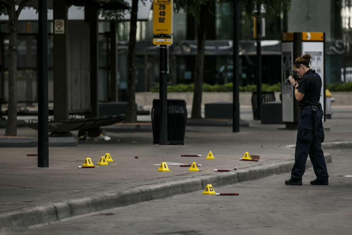 Investigators document the crime scene outside El Centro College in Dallas on Friday, July 8, 2016, where a sniper killed five police officers and wounded seven others during a protest over recent police shootings in Minnesota and Louisiana Thursday night. (Marcus Yam/Los Angeles Times/TNS)