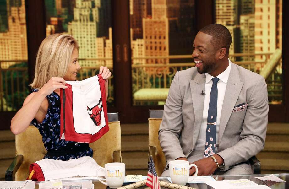 Television host Kelly Ripa interviews new Chicago guard Dwyane Wade. During the course of the interview, Wade chided former teammate LeBron James for being the cheapest player in the NBA. (AP photo)