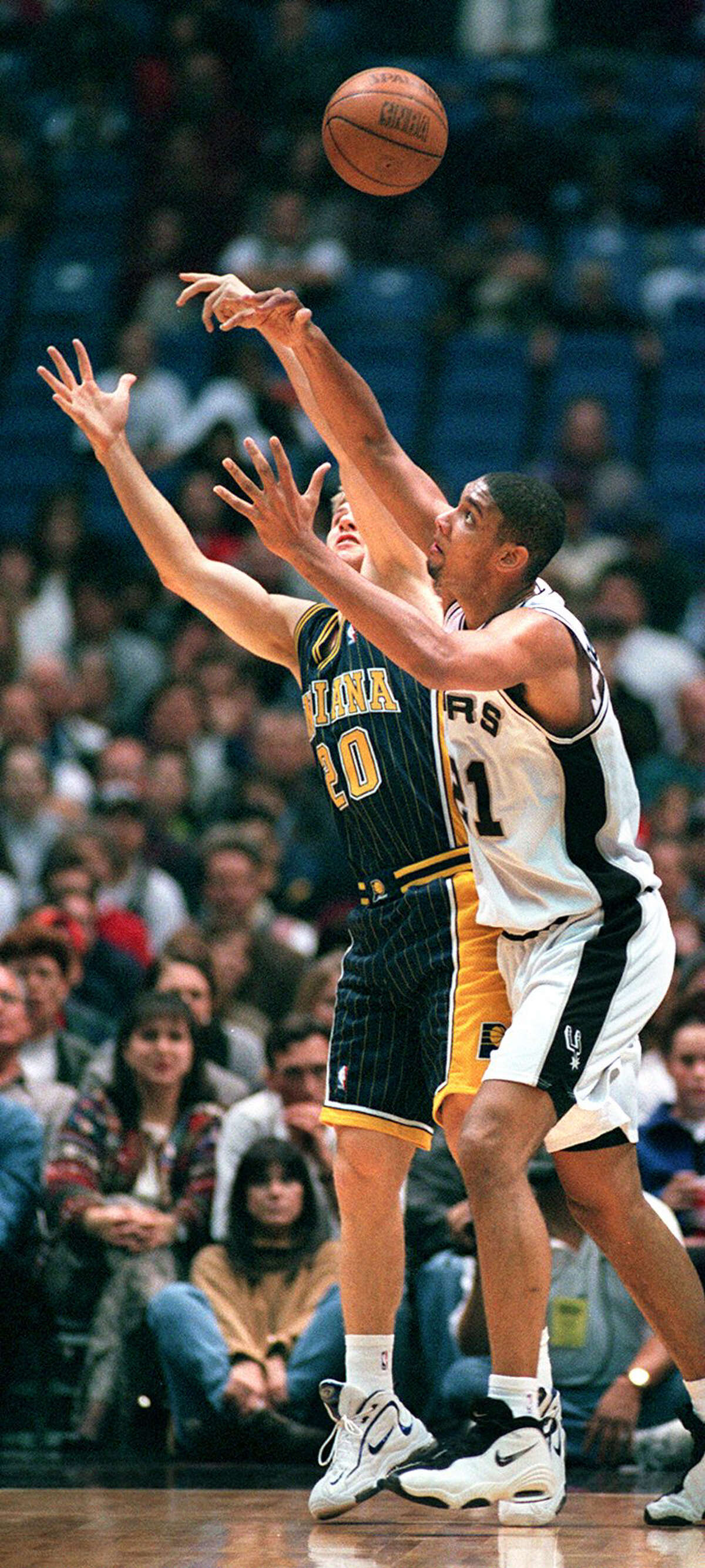 Indiana Pacer Fred Hoiberg(20) andSan Antonio Spur Tim Duncan(21) chase after a rebound during first half action Tuedsay December 23, 1997 at the Alamodome in San Antonio, Texas. AP PHOTO BY Edward Ornelas
