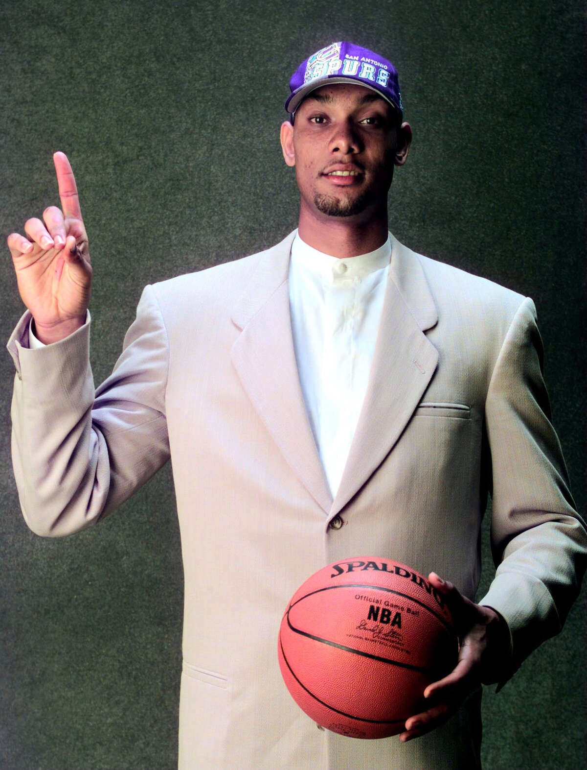 Former Wake Forest player Tim Duncan poses for a portrait after being selected by the San Antonio Spurs as the first pick overall in the 1997 N BA Draft in Charlotte, N.C., Wednesday, June 25, 1997. (AP Photo/NBA Photos, Andy Hayt)