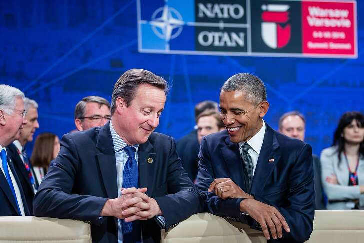 TOPSHOT - US President Barack Obama (R) and Great Britain's Prime Minister David Cameron (L) chat prior to the meeting of the heads of states of the North Atlantic Council (NAC), during the NATO summit in Warsaw, Poland. The Polish capital Warsaw hosts a two-day top-level NATO meeting, first time since Poland joined the alliance in 1999. / AFP PHOTO / WOJTEK RADWANSKIWOJTEK RADWANSKI/AFP/Getty Images