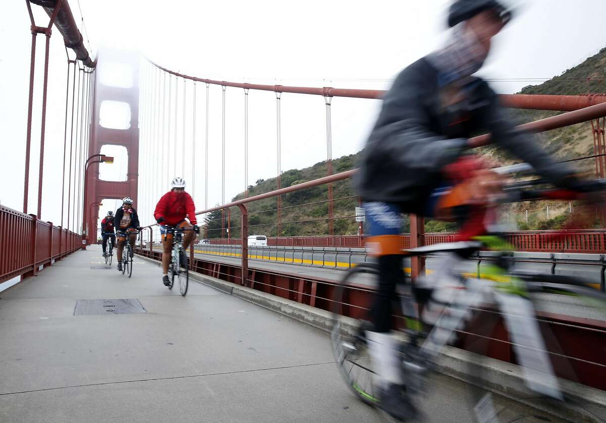 Bicyclists from the University of Texas raising money for cancer research ride across the Golden Gate Bridge in San Francisco, Calif. on Friday, July 8, 2016. Twenty-four bicyclists pedaled through San Francisco on a 70-day, 4,000 mile trek from Austin, Texas to Anchorage, Alaska. The Texas 4000 bike ride raises money for cancer research.