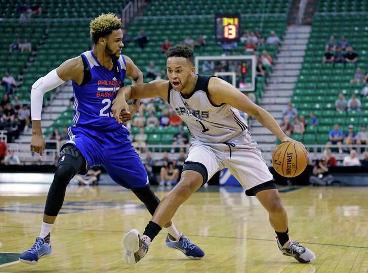 Philadelphia 76ers forward James Webb lll (23) defends San Antonio Spurs forward Kyle Anderson (1) during the first half of an NBA summer league basketball game Tuesday, July 5, 2016, in Salt Lake City. (AP Photo/Rick Bowmer)