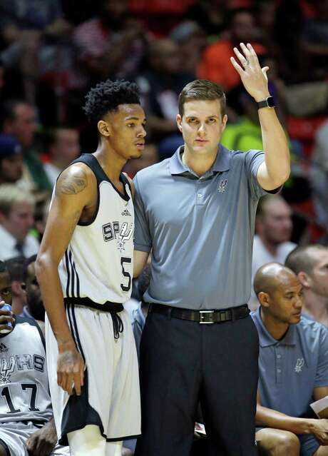 Spurs coach Will Hardy speaks with Dejounte Murray during the first half of a Utah Summer League game against the Boston Celtics on July 7, 2016, in Salt Lake City. Photo: Rick Bowmer /Associated Press / Copyright 2016 The Associated Press. All rights reserved. This material may not be published, broadcast, rewritten or redistribu
