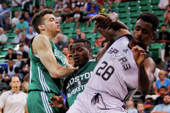 A foul is called on Boston's Terry Rozier as he and San Antonio's Livio Jean-Charles compete for a rebound during an NBA Summer League game on , July 9, 2015 at EnergySolutions Arena in Salt Lake City.