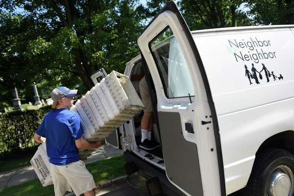 Nick Boardman, 16, loads a truck outside Neighbor to Neighbor in Greenwich on June 30. Neighbor to Neighbor is a nonprofit that provides food, clothing and basic living essentials to residents in need in the Greenwich area.