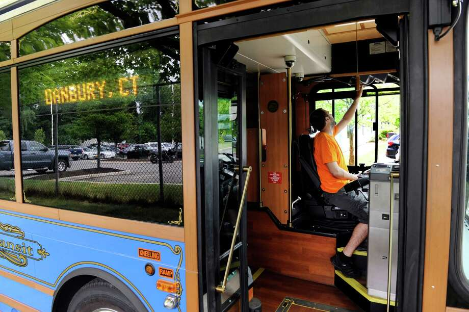 Drew O'Connell, marketing and communications director for HARTransit in Danbury programs the destination sign on the trolley to read Farmers Market, Friday, July 8, 2016. Hartransit is offering a free trolley service on Saturdays from 9:40 a.m. to 2 p.m. The service coincides with the return of the Danbury Farmers' Market, which is open in Kennedy Park from 10 a.m. to 2 p.m. every Saturday through October 22. Photo: Carol Kaliff / Hearst Connecticut Media / The News-Times