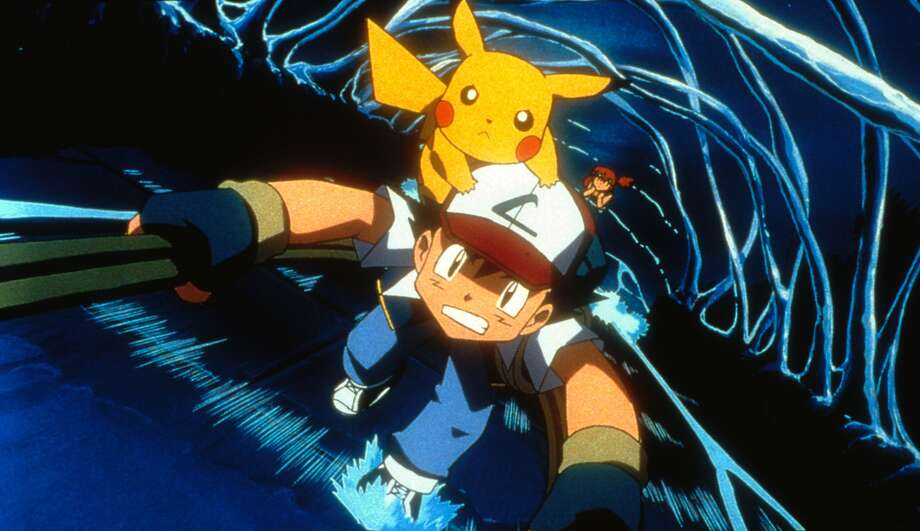 Ash, Pikachu and Misty (background) in 4Kids Entertainment's animated adventure 'Pokemon3,' distributed by Warner Bros. Pictures. (Photo by Warner Bros. Pictures)