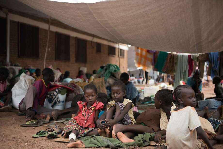 Children displaced by fighting wait to register at a Red Cross compound in Wau. Rival groups are warring despite the formation of a unity government. Photo: CHARLES LOMODONG, AFP/Getty Images