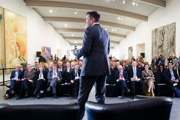 Elon Musk, CEO of Tesla Motors addresses an environmental conference at Astrup Fearnley Museum in Oslo, Norway on April 21, 2016.  / AFP PHOTO / NTB Scanpix / Heiko JUNGE / Norway OUTHEIKO JUNGE/AFP/Getty Images