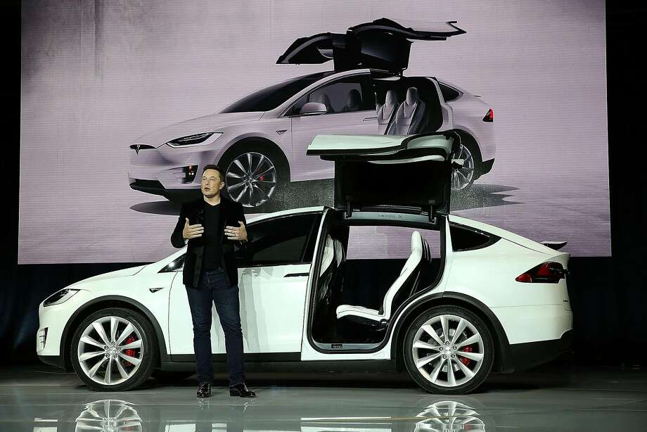 Tesla CEO Elon Musk speaks during an event to launch the Tesla Model X SUV in 2015. Tesla shareholders on Wednesday approved an unorthodox pay package for Musk that ties virtually all his compensation to a series of aggressive growth targets. Photo: Justin Sullivan, Getty Images