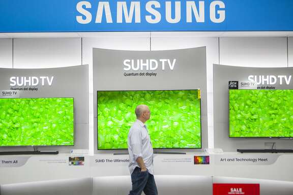 A costumer browses the TV section of Best Buy on Thursday, July 7, 2016 in San Francisco, California. The latest generation screens that retailers and manufacturers are pushing, you have to wade through terms like 4K, SUHD, Super UHD, UHD Alliance Certification, Dolby HDR and HDR 10