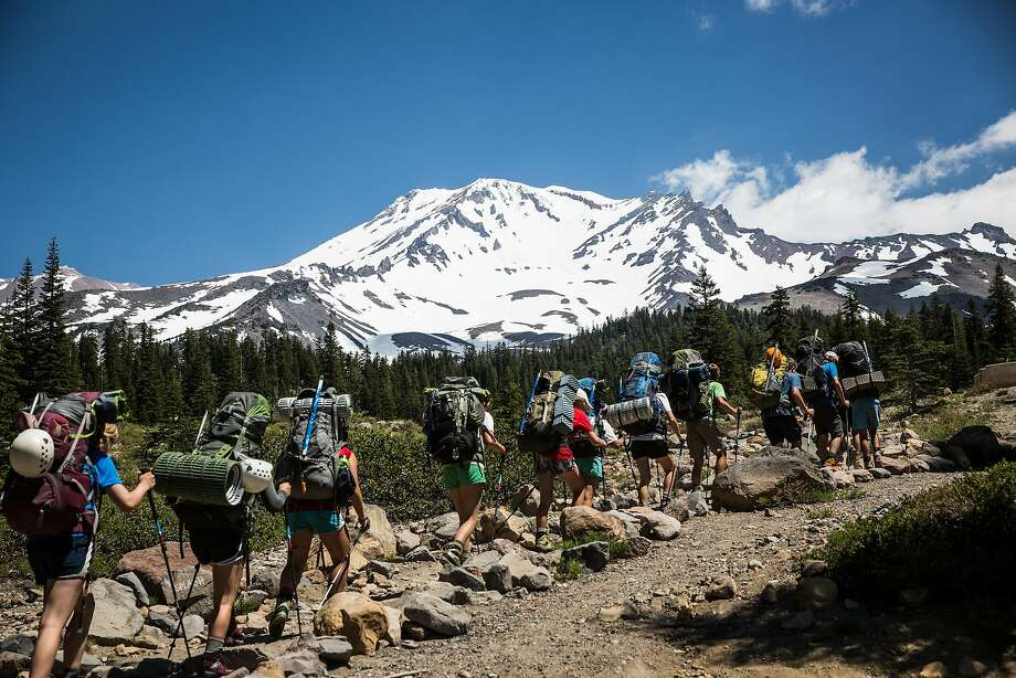 A group of climbers guided by Shasta Mountain Guides leave Bunny Flat to begin their climb up Mt. Shasta, June 29, 2016. Photo: Max Whittaker, Special To The Chronicle