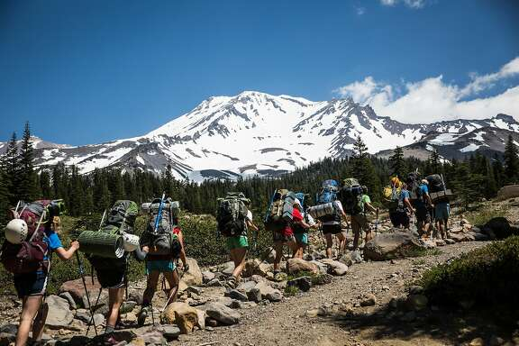 A group of climbers guided by Shasta Mountain Guides leave Bunny Flat to begin their climb up Mt. Shasta, June 29, 2016.