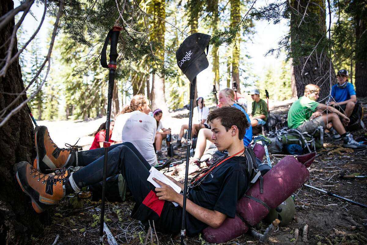 Kirin Hanay, 16, reads during a rest break while climbing Mt. Shasta, June 29, 2016.