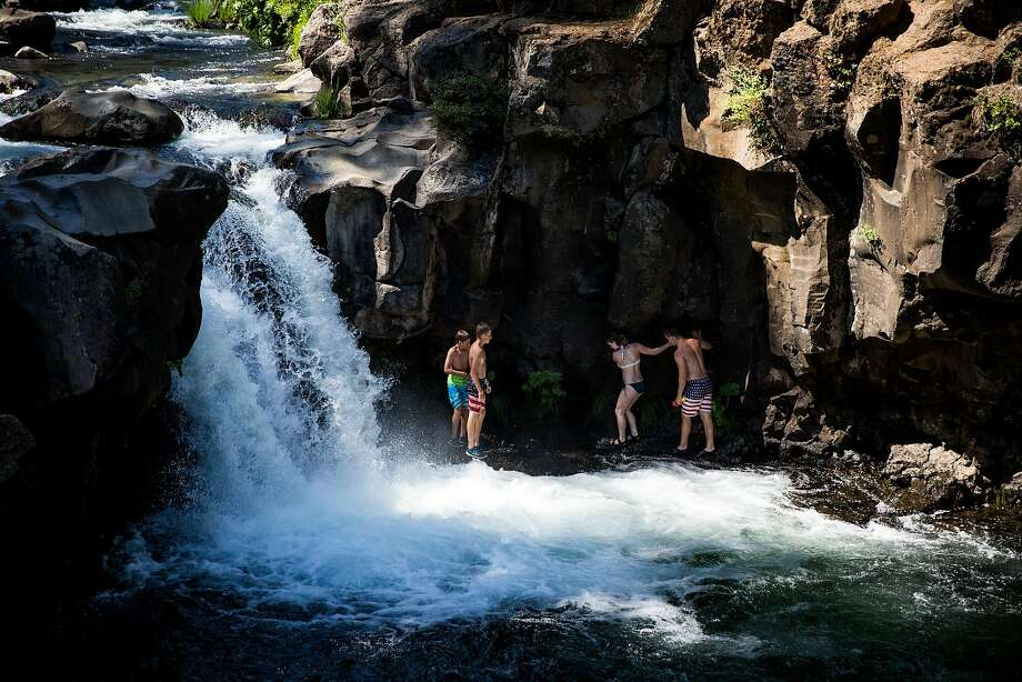 Visitors swim below Lower Falls on the McCloud River near McCloud, California, June 29, 2016. Photo: Max Whittaker, Special To The Chronicle