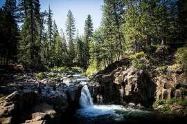 Visitors swim below Lower Falls on the McCloud River near McCloud, California, June 29, 2016.
