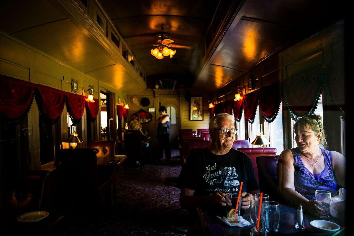 Darrel and Susan Hughes enjoy dinner in the Dinner House train car at Railroad Park Resort in Dunsmuir, California, June 29, 2016.