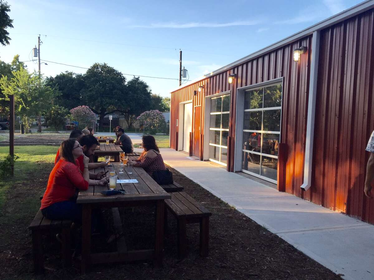 Outside the taproom, guests can sit near the garden.