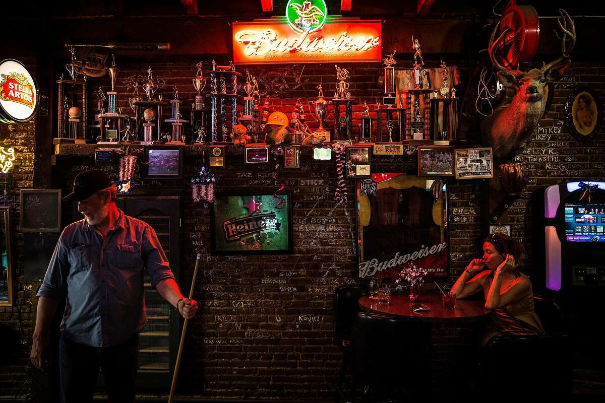 Ward Wilson, right, plays pool at The Diggin's bar in Weaverville, California, June 30, 2016.