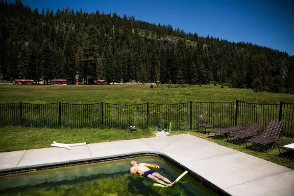 Randy Townsend floats in a pool fed by natural hot springs  at Drakesbad Guest Ranch in Chester, California, July 1, 2016.