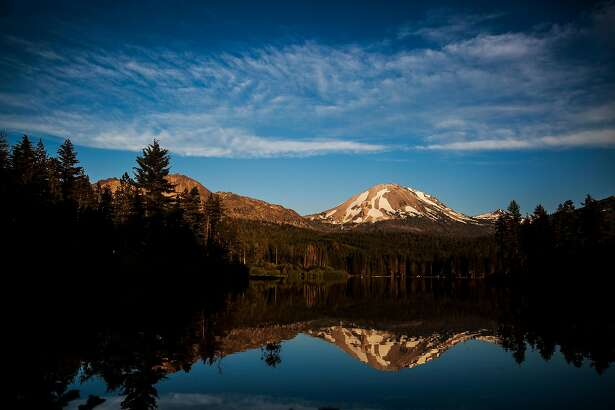 Mt. Lassen is reflected in Manzanita Lake in Lassen Volcanic National Park, California, July 1, 2016.