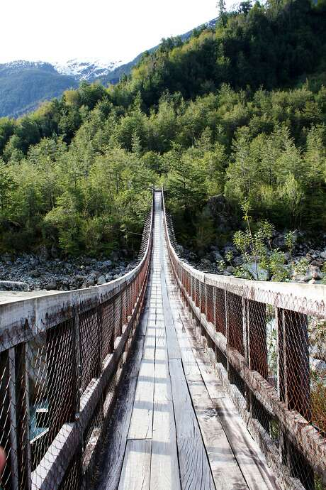 The bridge at the start of the hike to the Hanging Glacier in Queulat National Park. Photo: Yvonne Gordon, Special To The Chronicle