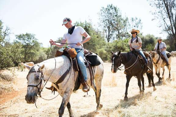 A guided trail ride at the Wild Horse Sanctuary in Shingletown, California, July 2, 2016.