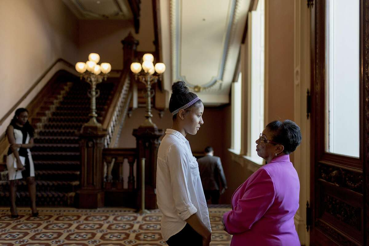 Cheryl Brown, a state assemblywoman, speaks with her granddaughter Kennedy Wilson at the California state capitol in Sacramento, June 22, 2016. Wilson recently graduated but didn�t bother to apply to state public universities after an adviser told her she would only be a good candidate if she were from out of state. � (Jason Henry/The New York Times)