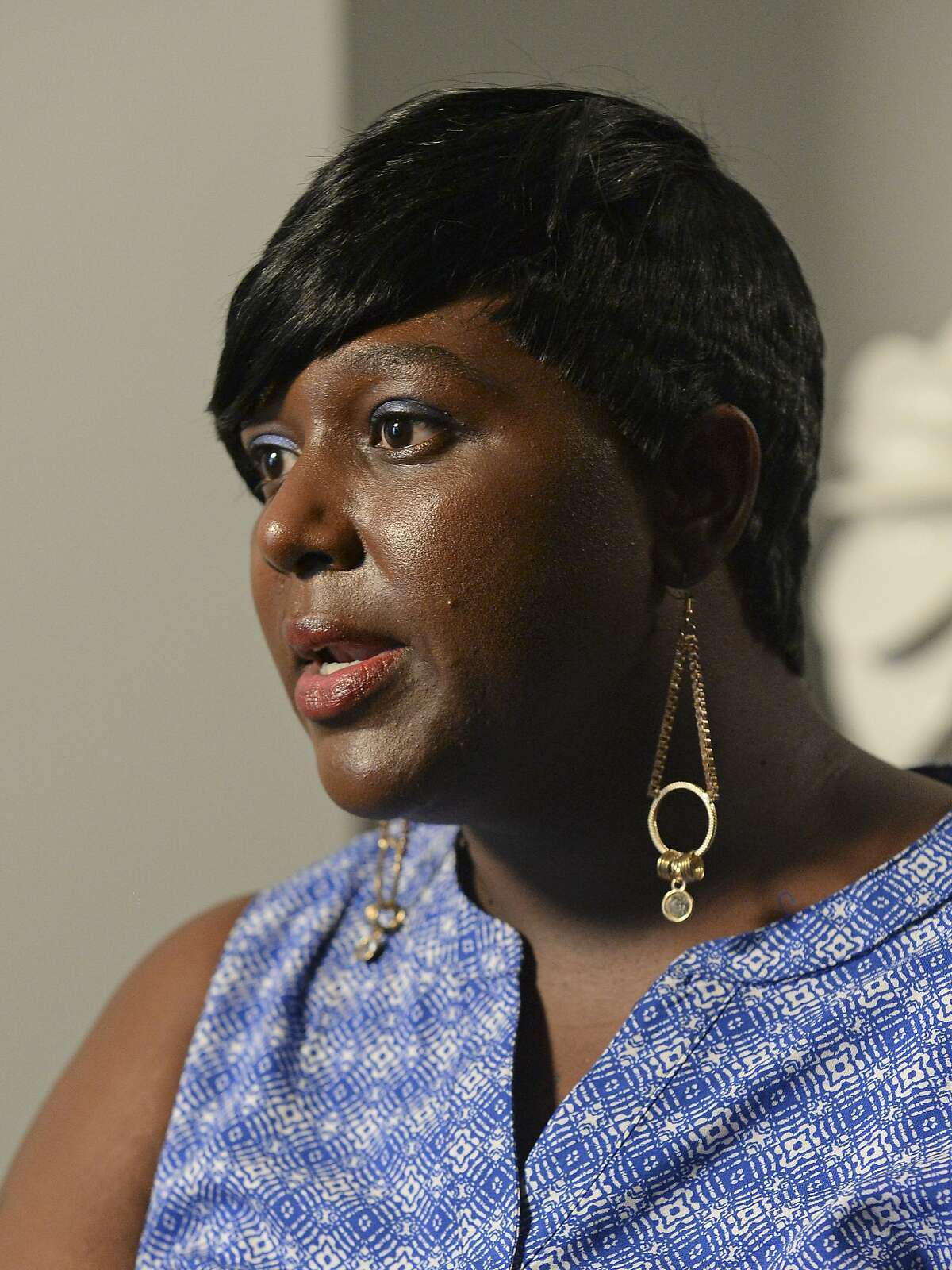 Quinyetta McMillon, the mother of Alton Sterling's 15-year-old son, Cameron Sterling, speaks during an interview in Baton Rouge, La., Friday, July 8, 2016. Alton Sterling, 37, was fatally shot Tuesday, July 5, in Baton Rouge, during a struggle with two police officers outside a convenience store. Sterling was black; both officers are white. (AP Photo/Hilary Scheinuk)