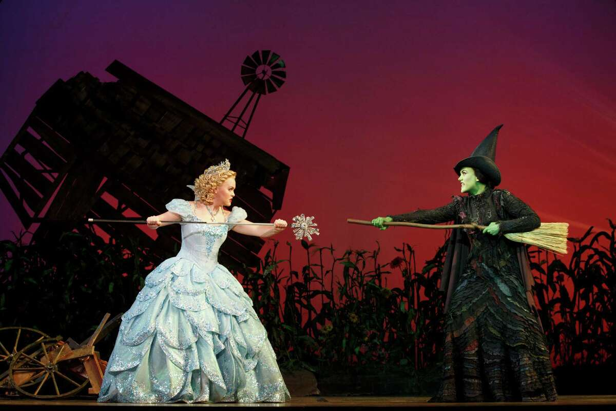 Amanda Jane Cooper, left, stars as Glinda opposite Emily Koch as Elphaba in the touring Broadway production of Wicked.
