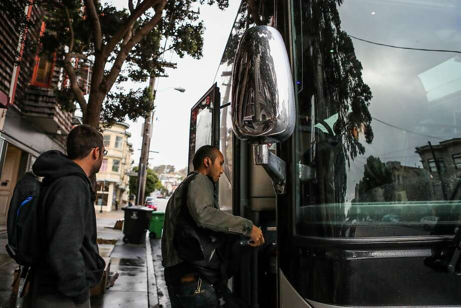 People board a tech bus on 16th Street in the Mission District, in San Francisco, California, on Friday, July 8, 2016. Photo: Gabrielle Lurie, Special To The Chronicle