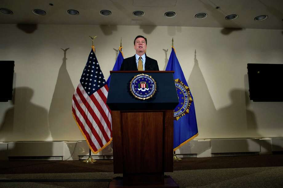 FBI Director James Comey announces his decision not to recommend criminal charges in its investigation into Hillary Clinton's use of a private email server while secretary of state. A reader disagrees. Photo: Cliff Owen /Associated Press / Cliff Owen