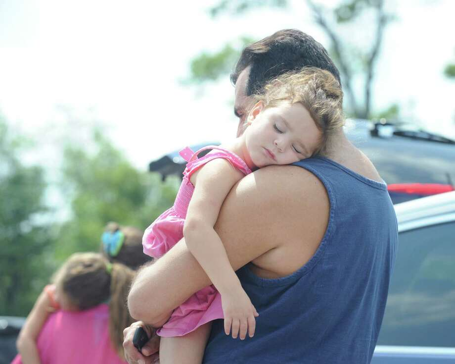 The 95 degree heat is even a little too much for Floridian Madeleine Arslan, 3, of Orlando, who is seen taking a nap on the shoulder of her dad, Michael Arslan, while the pair were on a family outing at Greenwich Point. Photo: Bob Luckey Jr. / Hearst Connecticut Media / Greenwich Time
