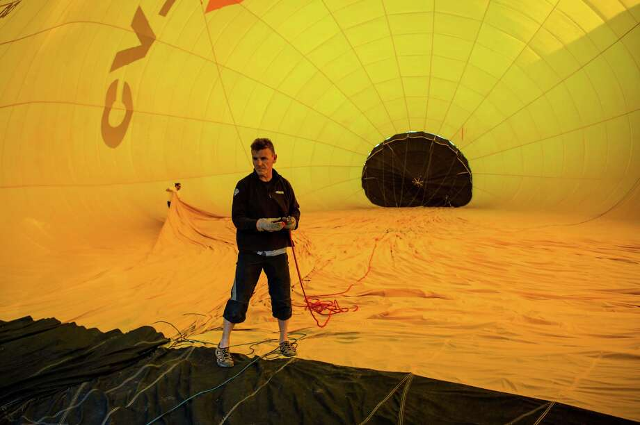 IGUALADA, SPAIN - JULY 07:  A hot air balloon is inflated at the European Balloon Festival on July 7, 2016 in Igualada, Spain. Now in its 20th year, the European Balloon Festival has become the most important hot air balloon events in Spain and one of the biggest in Europe. Photo: David Ramos, Getty Images / 2016 Getty Images