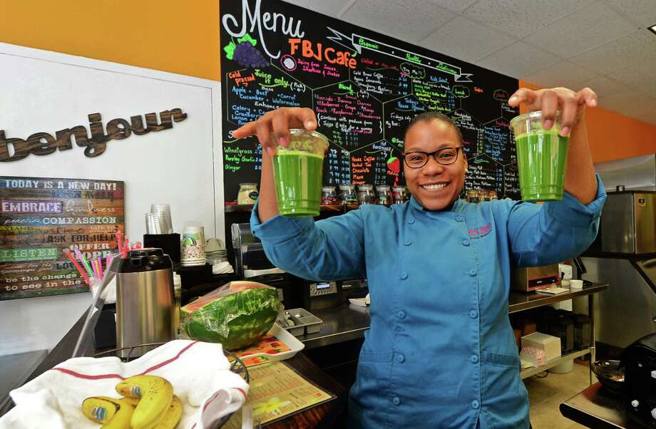 Fragrant Basil Juice Cafe owner Tanisha Williams on Friday, July 8, 2016, having reopened her business after a hiatus to relocate across the street to 11 Main Street in Norwalk, Conn. Photo: Erik Trautmann / Hearst Connecticut Media