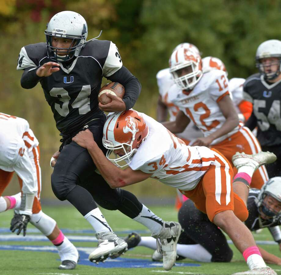 FILE PHOTO: ATI's Dominique Rogers (34) is caught by Michon Hunt (34) during the high school football between Capital Prep/Achievement First and Abbott Tech/Immaculate football teams on Saturday afternoon, October 24, 2015, played at Immaculate High School, in Danbury, Conn. Photo: H John Voorhees III / Hearst Connecticut Media / The News-Times