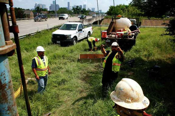 Workers take soil samples to be tested in preparation for future toll structures along Texas 288 on Friday, July 8, 2016, in Houston. (Annie Mulligan / Freelance)
