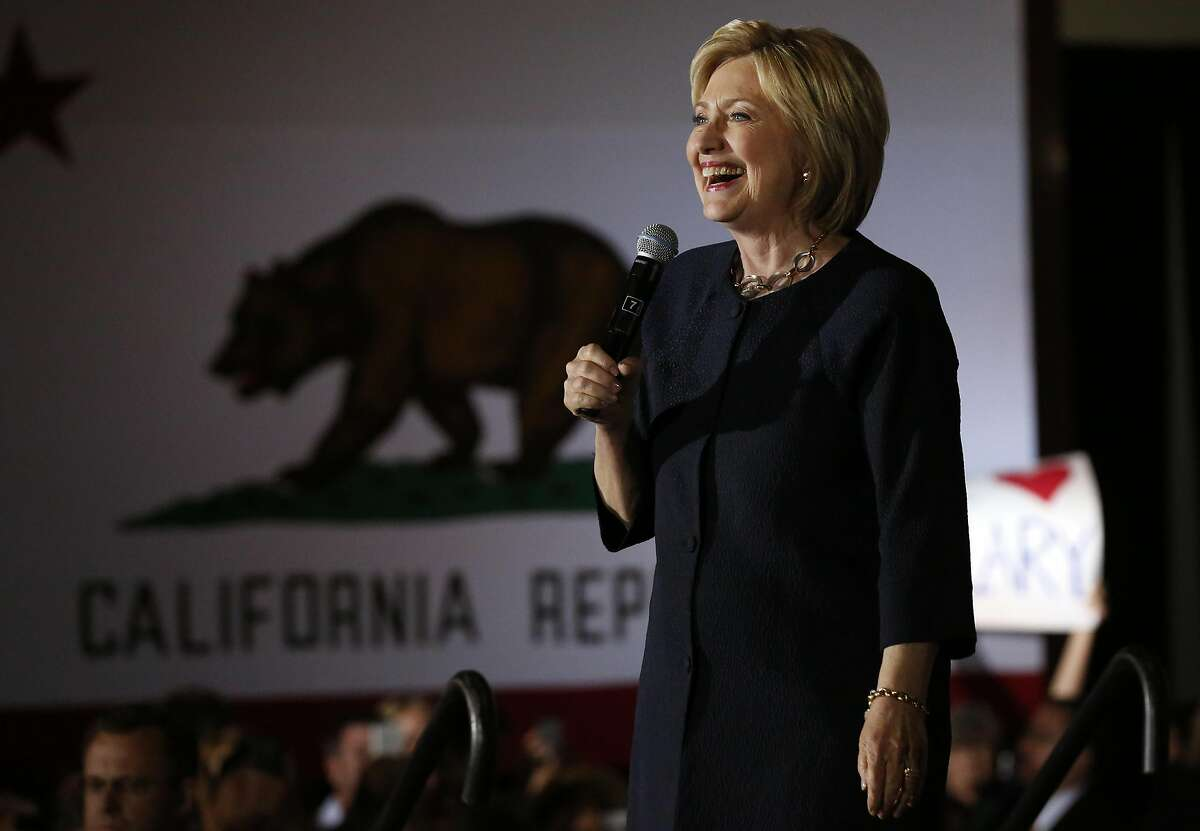 Presidential candidate Hillary Clinton reacts as the crowd welcomes her with loud cheers during a campaign stop at the Hibernia Bank in the Tenderloin May 26, 2016 in San Francisco.