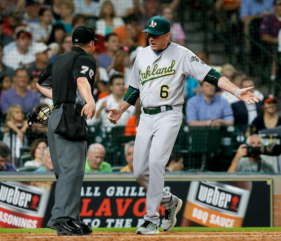 HOUSTON, TX - JULY 07:  Manager Bob Melvin #6 of the Oakland Athletics has words with umpire D.J. Reyburn #70 after he ejected Coco Crisp #4 in the fifth inning at Minute Maid Park on July 7, 2016 in Houston, Texas.  (Photo by Bob Levey/Getty Images) Photo: Bob Levey, Getty Images