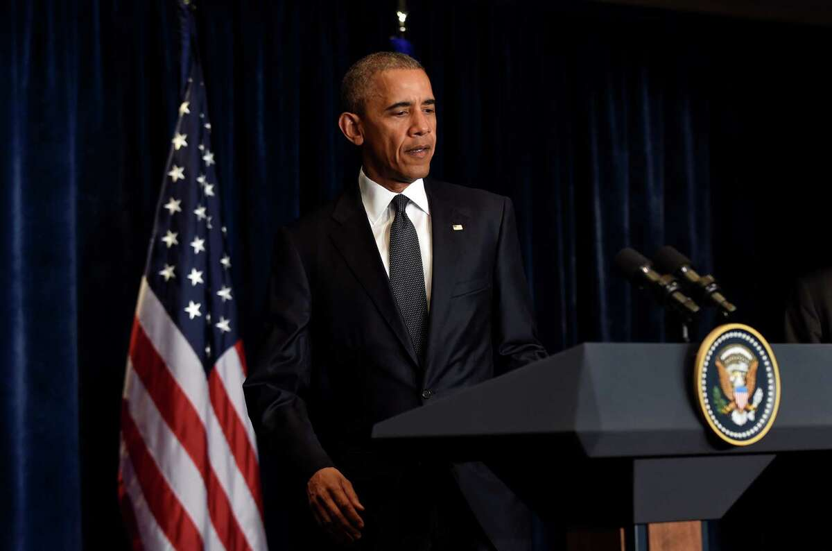 President Barack Obama arrives to addresses the overnight shooting of police officers in Dallas, Texas, in Warsaw, Poland Friday, July 8, 2016, before attending the NATO Summit. (AP Photo/Susan Walsh)
