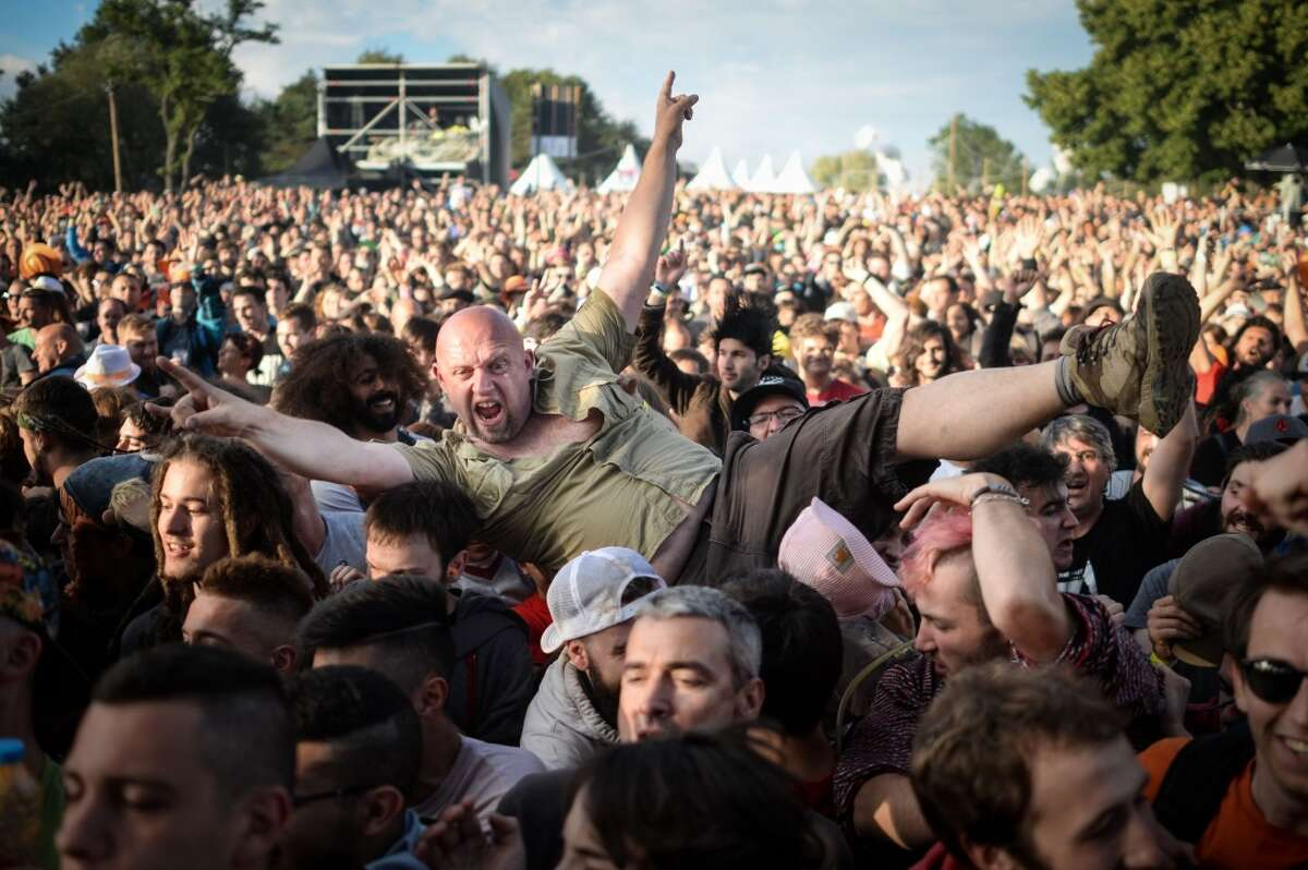 People react to a concert during the 28th Eurockeennes rock music festival on July 2, 2016 in Belfort, eastern France.