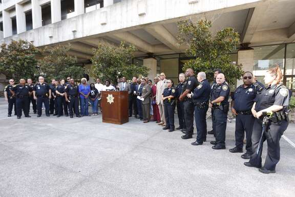 Harris County Constable Alan Rosen of Precinct 1 is shown at a vigil at 1115 Congress in Houston on Friday.