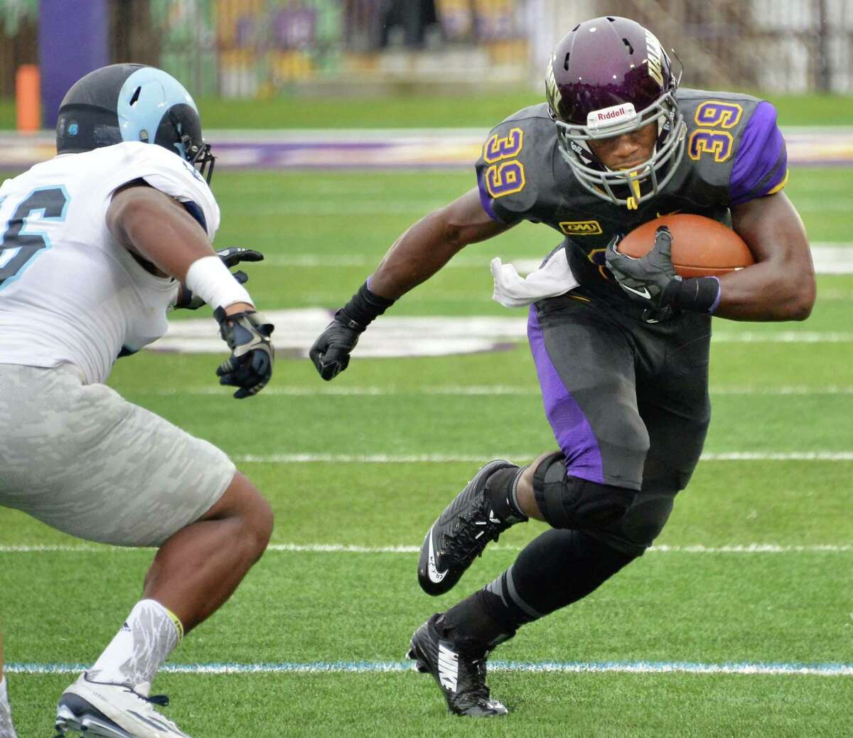 UAlbany's #39 Elliot Croskey, right, runs around Rhode Island's Adam Parker during Saturday's game at Bob Ford Field Sept. 12, 2015 in Albany,NY. (John Carl D'Annibale / Times Union)