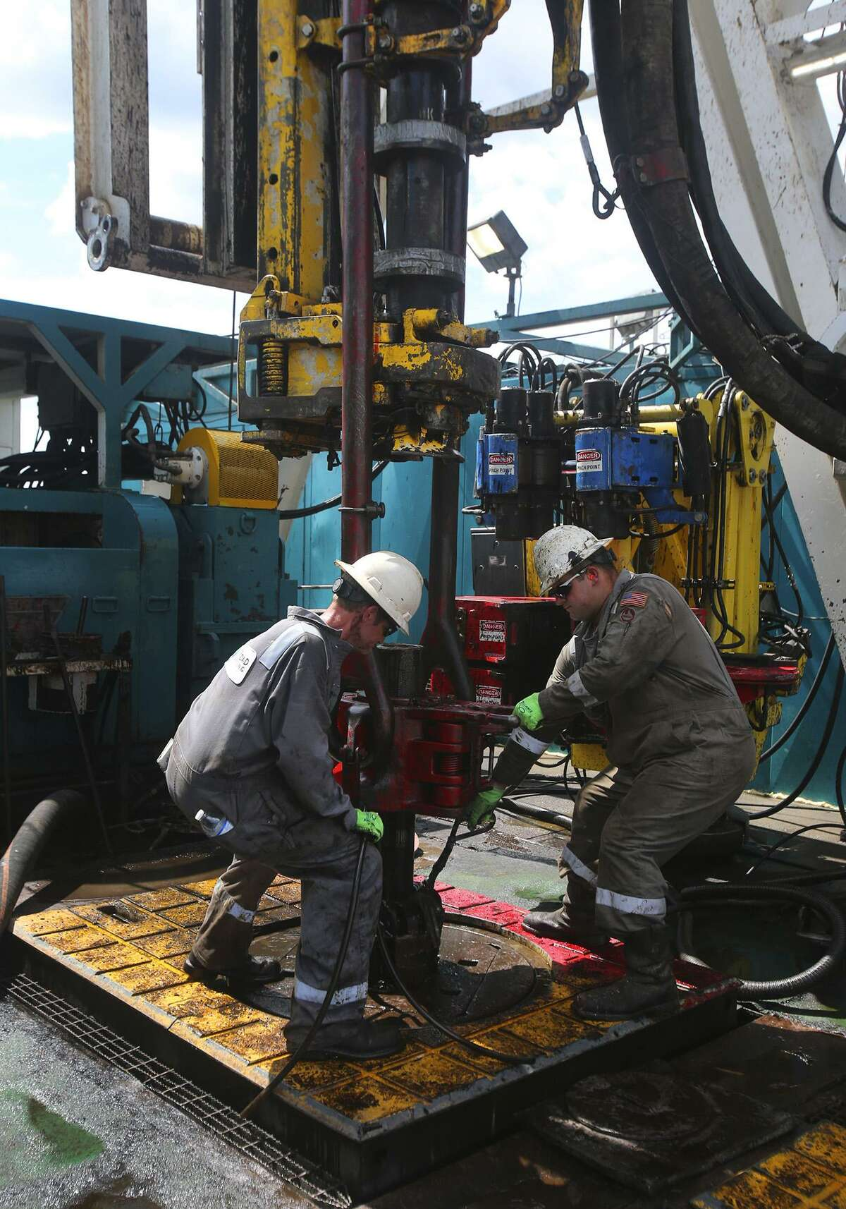 Floor hands work Monday June 27, 2016 at Abraxas Petroleum's Bullseye 101H well in Atascosa County near Jourdanton, Texas. Drilling activity picked up slightly this week in South Texas' Eagle Ford Shale and in Oklahoma while the nation's overall rig count stayed relatively flat.