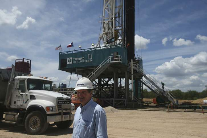 Abraxas Petroleum Corp. CEO Bob Watson walks past the Bullseye 101H well Monday June 27, 2016. The well was being drilled in Atascosa County near Jourdanton into the Austin Chalk formation which overlays the Eagle Ford formation.