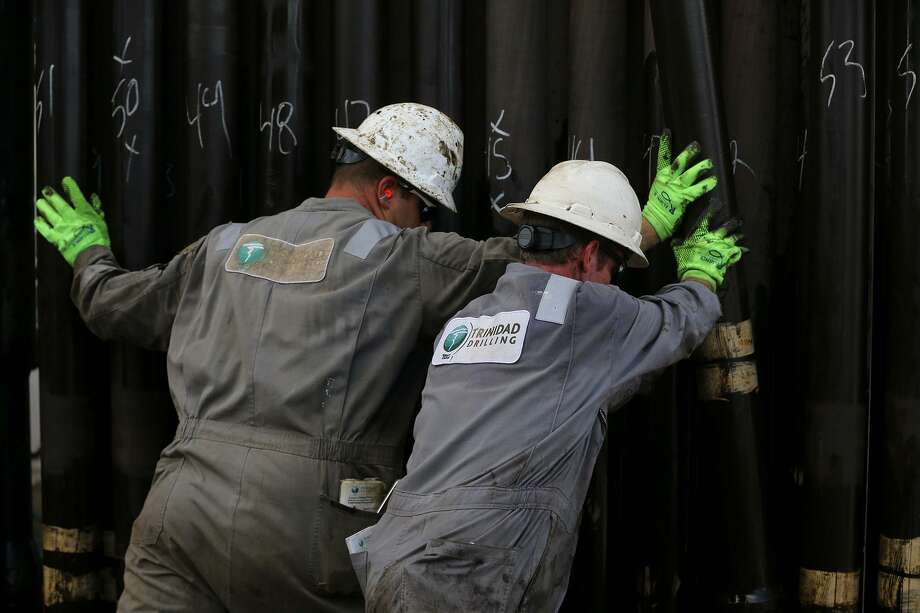 Floor hands move casing Monday June 27, 2016 at Abraxas Petroleum's Bullseye 101H well being drilled in the Austin Chalk formation in Atascosa County near Jourdanton, Texas. The Austin Chalk-a formation drilled for decades in South Texas-is seeing renewed interest from oil and gas companies working the Eagle Ford formation. The Austin Chalk formation lies atop the Eagle Ford. The oil industry is in an increasingly bullish mood, but the ongoing push-pull between U.S. oil producers and the Organization of the Petroleum Exporting Countries isn't over yet. Photo: John Davenport /San Antonio Express-Newss / ©San Antonio Express-News/John Davenport