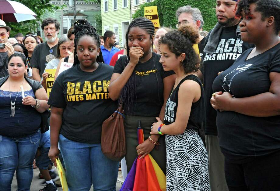 People gather in Dana Park to mourn the lives of five black and brown men killed by police this week on Friday, July 8, 2016 in Albany, N.Y. Also honored was the life of Goddess Diamond, the 14th Black trans woman killed this year. (Lori Van Buren / Times Union) Photo: Lori Van Buren / 20037276A