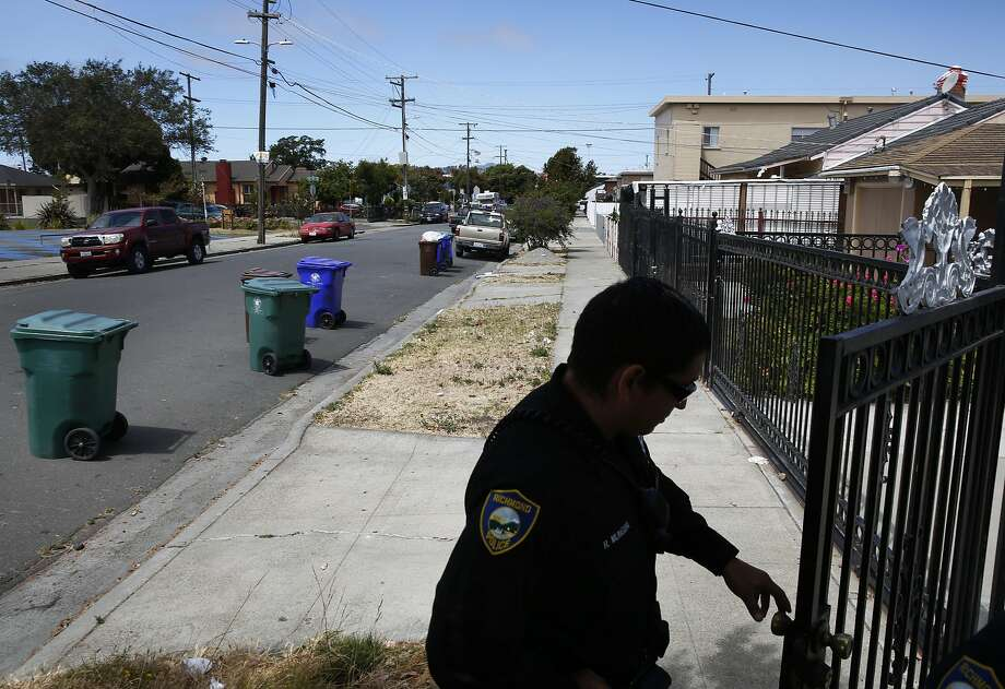 Ruben Munguia is a police officer in Richmond, leaves the home of a mother whose daughter had run away a few days prior after helping a colleague translate from Spanish to English during Munguia's shift July 7, 2016 in Richmond, Calif. Photo: Leah Millis, The Chronicle