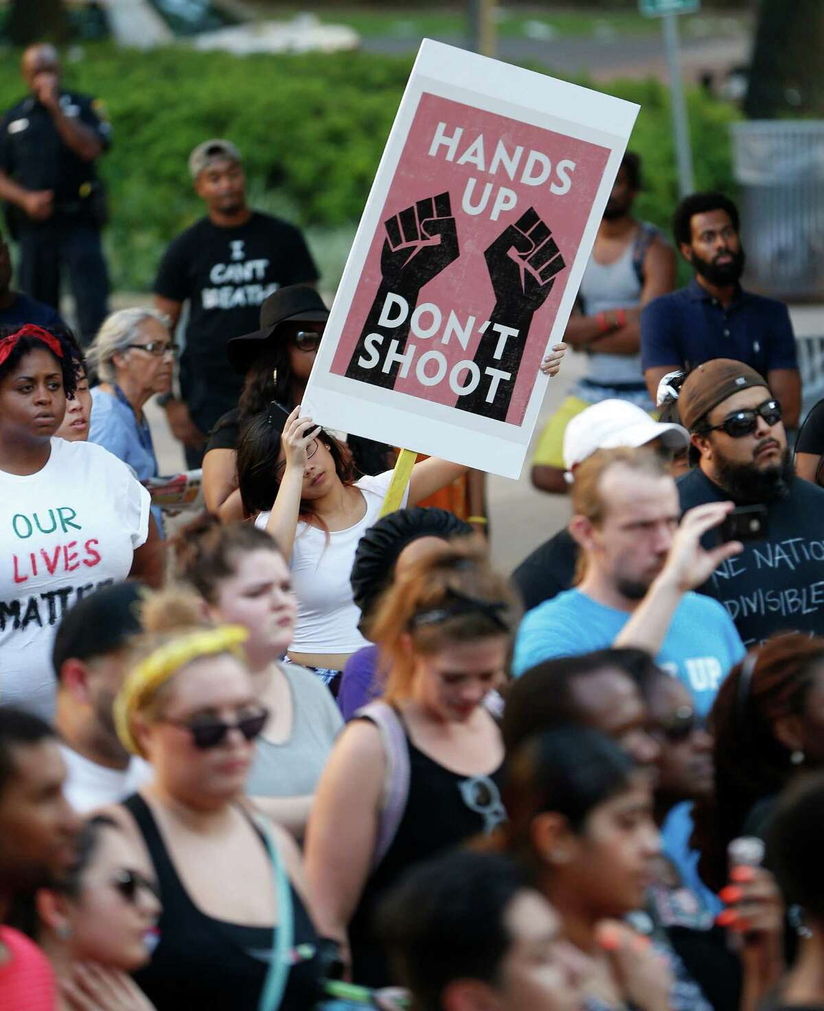 A protester holds a sign during a Black Lives Matter rally that began at Discovery Green and ended at City Hall, Friday, July 8, 2016, in Houston.